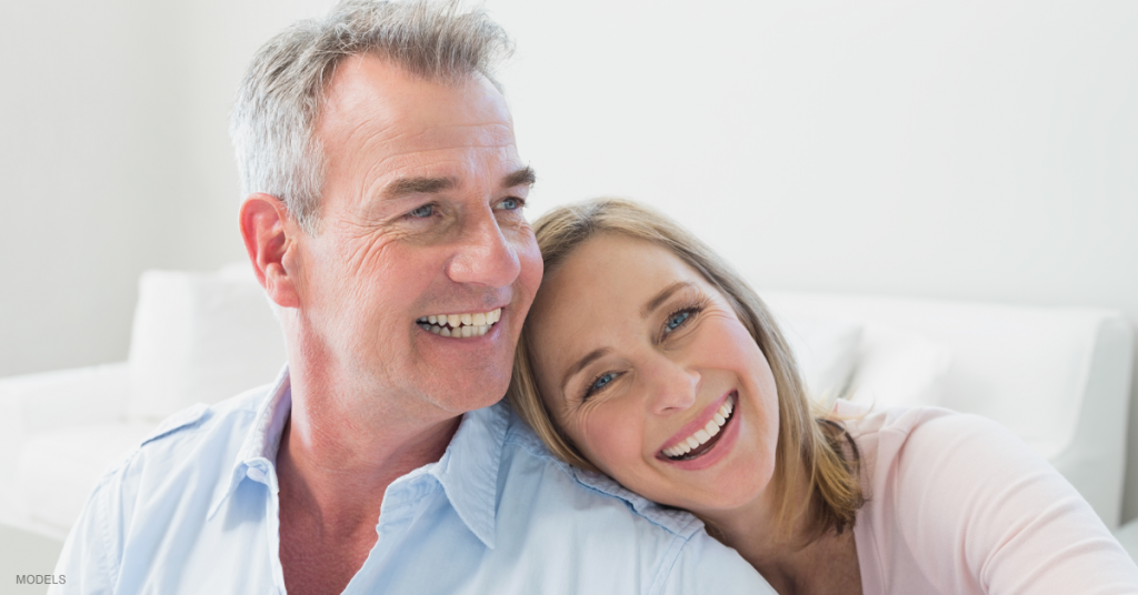Middle aged man and woman smiling