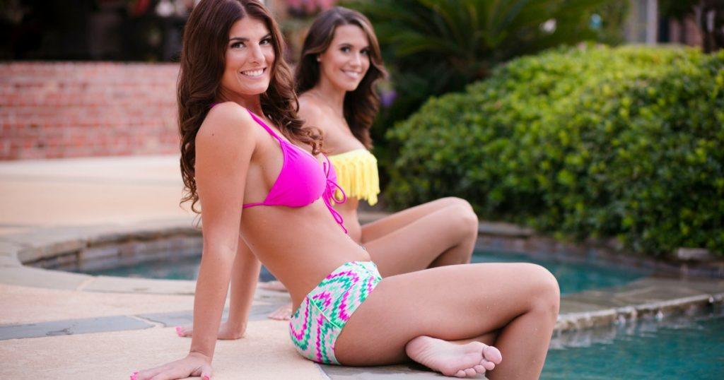 Two Actual Breast Patients Sitting In Bikinis By the Pool
